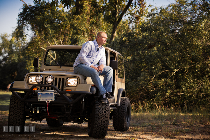 Guy sitting on front of his Jeep. Eastern Shore, Maryland, Kent Island High School senior portrait session by photographer Leo Dj Photography. http://leodjphoto.com
