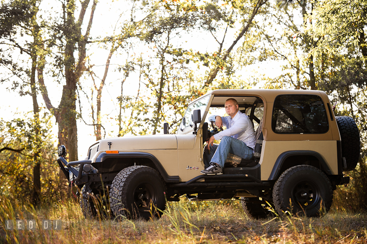 Guy sitting inside his Jeep in a forest. Eastern Shore, Maryland, Kent Island High School senior portrait session by photographer Leo Dj Photography. http://leodjphoto.com