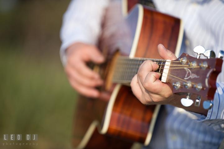 Detail shot of guy playing guitar. Eastern Shore, Maryland, Kent Island High School senior portrait session by photographer Leo Dj Photography. http://leodjphoto.com