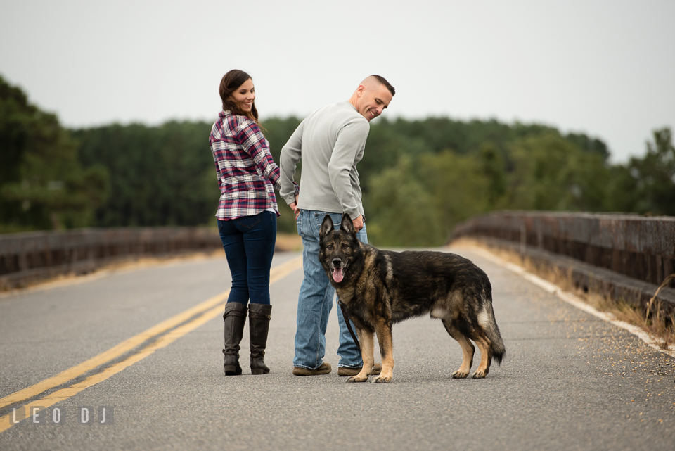 Wye Island Queenstown Maryland engaged man walking with his fiancée and dog photo by Leo Dj Photography.
