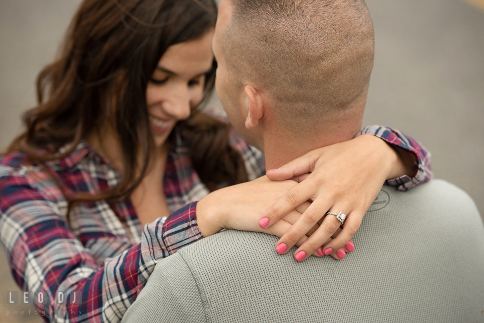 Wye Island Queenstown Maryland engaged girl embraced her fiancé and showed her engagement ring photo by Leo Dj Photography.