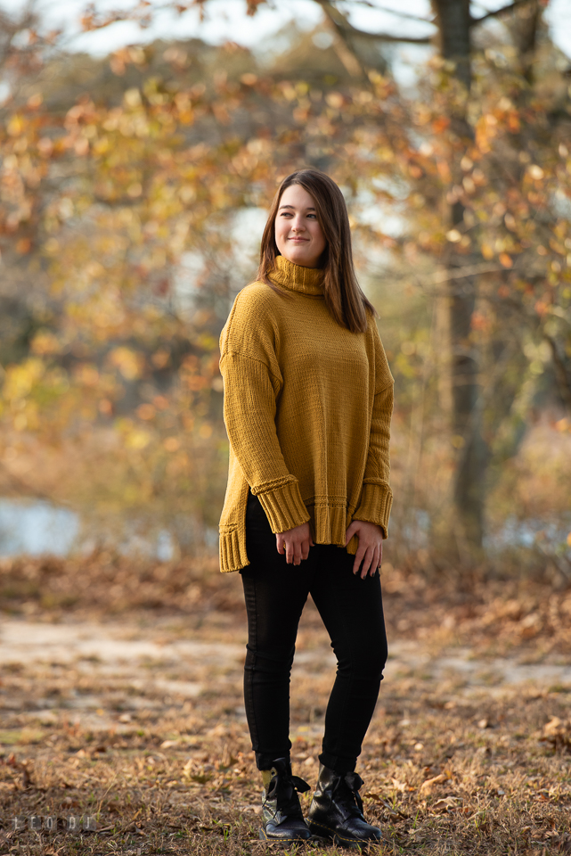 Kent Island High School Maryland senior by a creek in autumn photo by Leo Dj Photography.