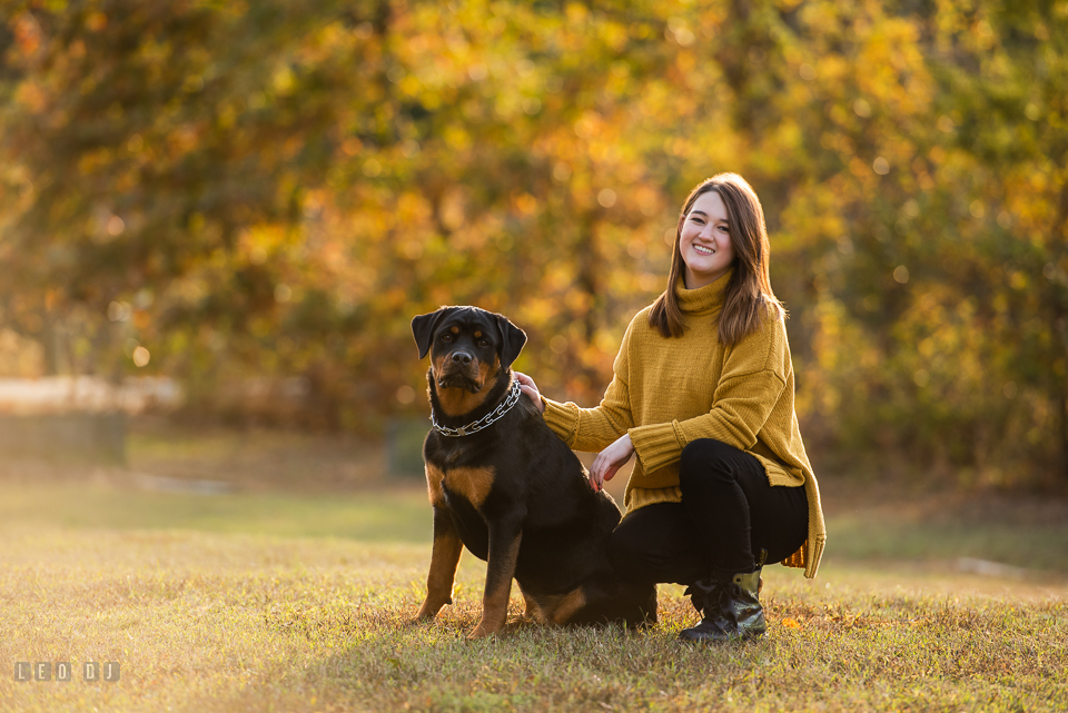 Kent Island High School Maryland senior with her dog in autumn photo by Leo Dj Photography.